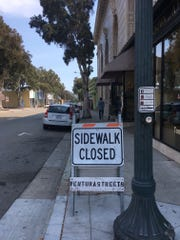 The city has put up Sidewalk Closed signs at Main and