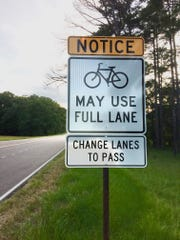 This sign on the Natchez Trace Parkway near the Ridgeland exit warns drivers that cyclists are allowed to use the entire right lane while riding.