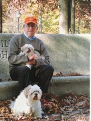 Peter Cronk with his dogs, Chiang and Cixi.