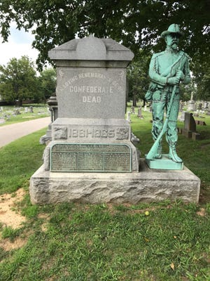 A monument remembering 24 dead Confederate prisoners of war who died in Evansville stands in Oak Hill Cemetery on Tuesday.