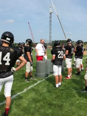 SPASH aasistant football coach Matt Heilman goes over a defensivce line drill with players during a recent practice.