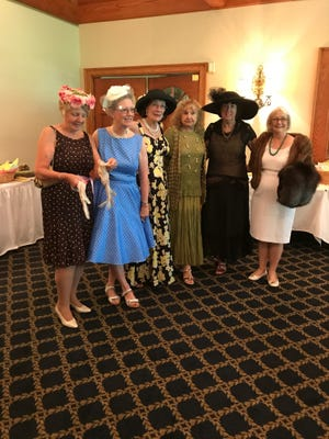 Celebrating the 80th anniversary of the Sussex Gardeners Club at a luncheon at Kings Creek Country Club members dressed in vintage attire. From left are: Donna Fellows, Kathy Ackerman, Marty Last, Lucy Fleming, Willa Jones and Karen Coombe.