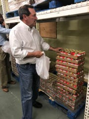 Sen. Joe Donnelly packs food for low-income EVSC students at the Tri-State Food Bank in Evansville on Thursday.
