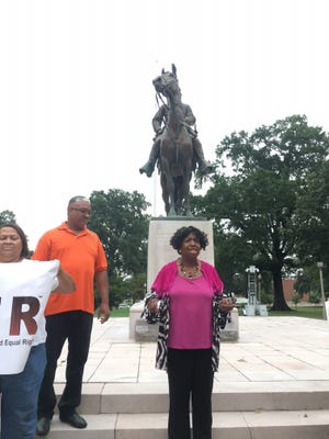 State Rep. Johnnie Turner, D-Memphis, (center) speaks at a demonstration in front of the Nathan Bedford Forrest statue on Monday.