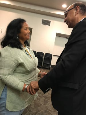 Carmel resident Lucille Pittard shares a moment with Khizr Khan, as she explains that her husband served in the same battalion as Khan's late son.