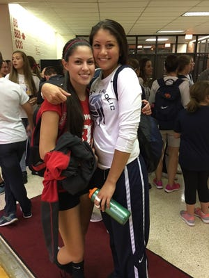 Sisters Anna Schmdt of Richmond High School, left, and Abbey Schmidt of Seton Catholic, have found success - in different ways - on the volleyball court. They meet Tuesday night at Seton Catholic.
