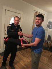 Jonathan Pring turns his guns over to Phoenix police