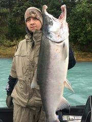 KSP Detective Matt Wise shows his catch during an Alaskan
