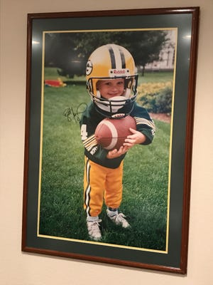 A 3-year-old Ryan Ramczyk shows his true colors in his Green Bay Packers attire in the backyard of the family home.