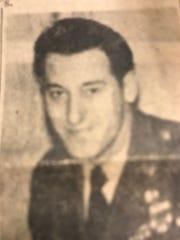 Wesley Kerr is seen dressed in his military uniform.