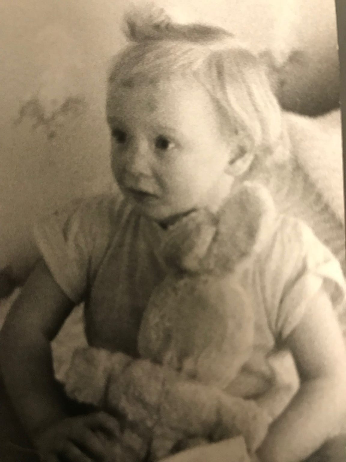 Elizabeth Duncan's 3-year-old daughter clutches her stuffed bunny after police found her mother shot to death on March 27, 1955. Elizabeth Duncan, along with Goebel Duncan and Raymond Duncan, were the final victims of Evansville serial killer Leslie Irvin.
