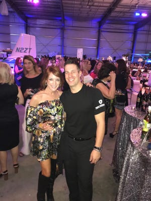 Ron Toperzer, right, with Karen Franke, co-chair of Dancing With Vero's Stars and past winner of the mirror ball trophy, at the Nov. 9 Wine Women & Shoes benefit for the Humane Society of Vero Beach and Indian River County.