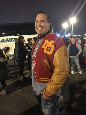 Mount Olive class of '92 graduate Michael Maher shows off his football letter jacket at the NJSIAA North 1 Group IV final.