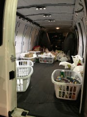 A van donated by Bruce Woodring gets loaded with canned