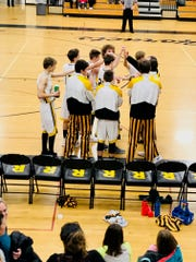 Rosholt players huddle before the opening tip-off of