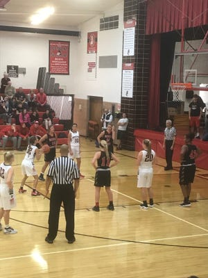 Pleasant's Erika Linder lines up a free throw attempt at home against Marion Harding last week.