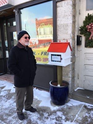 John Miller and his wife, Judy, opened a Little Free Library Friday in Bellevue on Main Street.