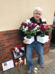 Ed Book, a 10-year New Rochelle resident, contributed two bouquets to the memorial for high school student Valaree Schwab, who was stabbed to death on Wednesday.