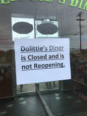 A sign hangs on the door of DoLittle's Diner in Stuart's Draft.
