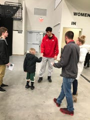 Former Wisconsin Badgers basketball player Duje Dukan greets fans following Saturday's Wisconsin Herd game at the Menominee Nation Arena in Oshkosh. Dukan plays for the Windy City Bulls.