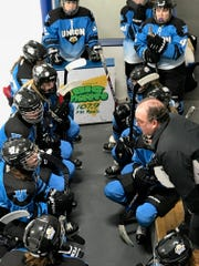 Wisconsin Valley Union coach Dan Bauer huddles with his players during a timeout in the third period at Ice Hawks Arena on Saturday night.
