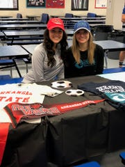 Estero High soccer players Sophie Restrepo (Arkansas State) and Haley DeSanto (Eckerd College) signed their Letter of Intent during a Signing Day Ceremony Wednesday at Estero.