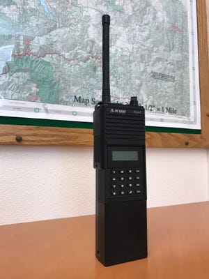 Radios like this one are used by firefighters to communicate on fire lines.