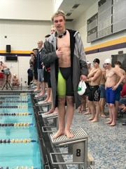 D.C. Everest sophomore Payton Rudeen stands on the first-place platform after winning the 100-yard breaststroke to qualify for state at the Wisconsin Rapids Sectional on Saturday at UW-Stevens Point.