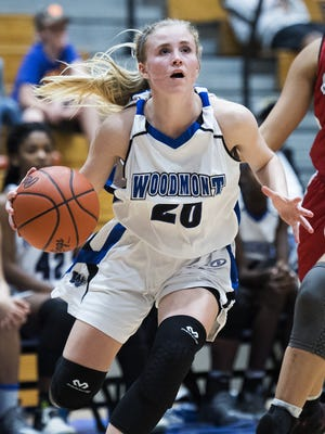 Xan Rowland (20), shown in an early season game, scored 11 points for Woodmont in its 54-41 win over visiting Hillcrest in their Class AAAAA second-round playoff game Friday night at Ben Abrams Gymnasium.