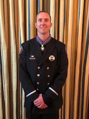 Firefighter Stephen Gunn receives the Medal of Valor from President Trump on Feb. 20