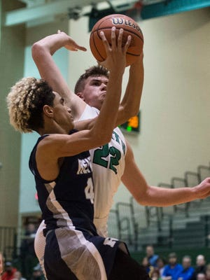 Reitz's Khristian Lander (4) goes up for a layup against North's Cameron Seaton during the Class 4A North Sectional semis. He is perhaps considered another Mekhi Lairy.