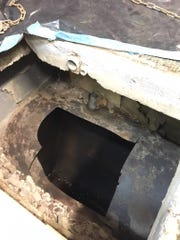 The remains of an underground tank in the Franklin Village Plaza in Franklin are seen in mid-March, 2018, under flooring of a tailor's shop, after contractors from the Michigan Department of Environmental Quality cut off the top of the tank and removed what investigators believe was decades-old dry-cleaning fluid.