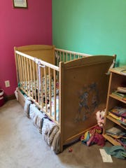 Prior to getting the Safety Sleeper bed, Vanessa slept in a crib rigged over a twin bed to keep her confined and safe at night.