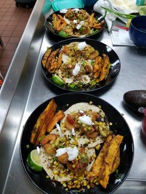 Contestant Dina Roosth's Acapulco shrimp tacos served with roasted sweet potato wedges, sour cream , and avocado pico de gallo she had made at home.