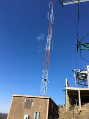 A manclimbed a 200-foot tower at the top of the Pine Knob Ski Resort in an attempt to commit suicide.
