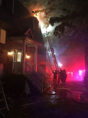 Firefighters battle a blaze at Arundel Apartments in