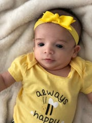 Ryan Redmond, who is 2 months old, was born with Treacher Collins syndrome, a rare genetic disorder. Her father James Redmond, a native of Medford, recently competed in the Popular Brooklyn Half-Marathon to raise awareness about her disorder, which affects craniofacial bone development.