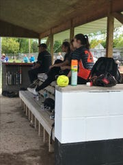 Port Edwards softball players check out the action