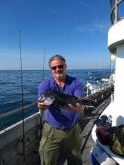 Andy Benacchio of Howell with a sea bass he landed