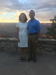 Madalene Laudani and Mark Koehler pose overlooking the South Rim before dinner at a Grand Canyon lodge several hours after their wedding hike.