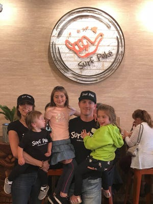 Jay and Caitlin Gould, owners of Surf Poké, and their children Jada, Kira and Jason.