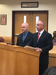 Flint officer Mark Boudreau (left) with his attorney