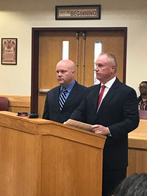 Flint officer Mark Boudreau (left) with his attorney Frank Manley (right) at Boudreau's arraignment in Livingston County Monday June 11, 2018