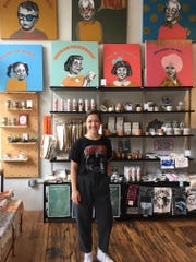 Paris Woodhull, manager/buyer for Rala in the Old City, welcomes Waldo seekers to the colorful store, which features fanciful, clever art and accessories by local makers.