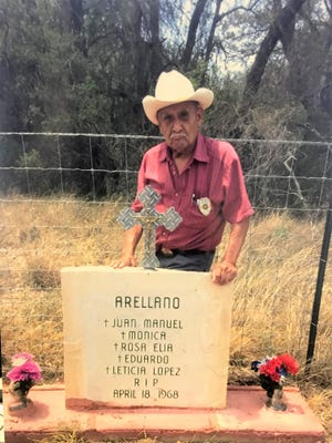 Julio Hernandez stands next to a monument for the Arellano family 34 miles south of Sonora, where they were murdered in April of 1968. The perpetrator has never been caught. Not pictured are Mario Lira, Fred Perez, Ramiro Martinez, who helped set the marker, and Pete Gomez Sr. who commissioned it.