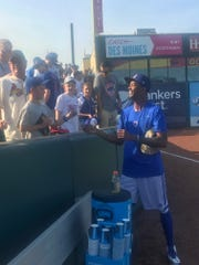 Carl Edwards Jr. signs some autographs before Friday's Iowa Cubs game at Principal Park in Des Moines.