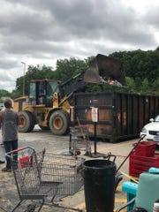 Hy-Vee brought in special equipment to help clean up debris and damaged merchandise after heavy rain flooded the Harding Hills store June 30.
