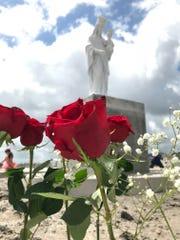 A red rose decorates the Regina Caeli Shrine at St. John the Baptist Catholic Church in Corpus Christi.