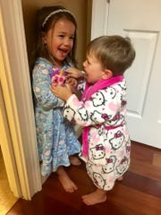 Playing with his sisters was one of Levi Hughes' favorite