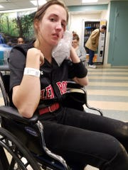 Ellen Feuss holds an ice pack to her chin at the hospital.